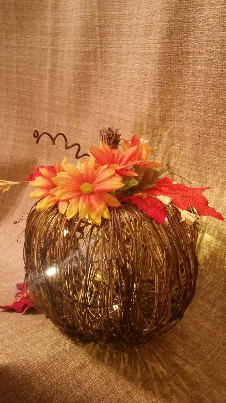 Lit by mini LED lights small battery operated. Pretty pumpkin