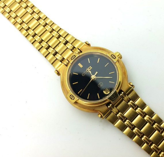 0a86c9d34da Vintage 18K gold Plated and stainless steel Gucci 9200L wrist
