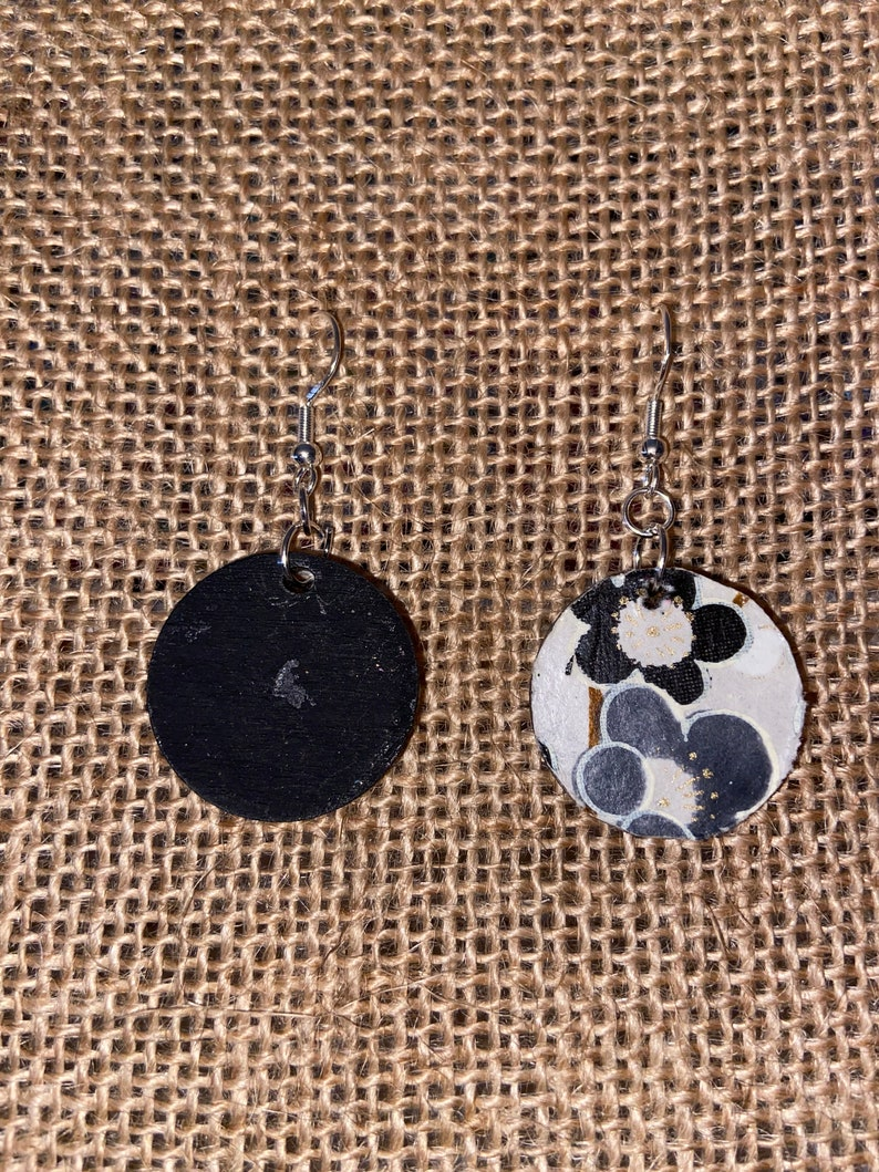 Black painted small wooden circles with fun Italian paper.