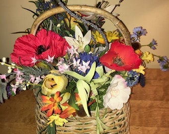 Beautiful Floral Arrangement in Picnic Basket