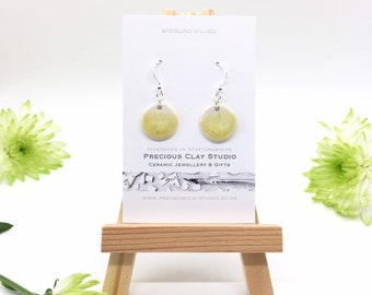 Circle earrings, yellow/natural. (Sterling Silver)