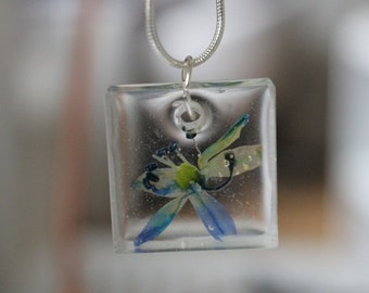 Silver necklace with resin pendant, real flower
