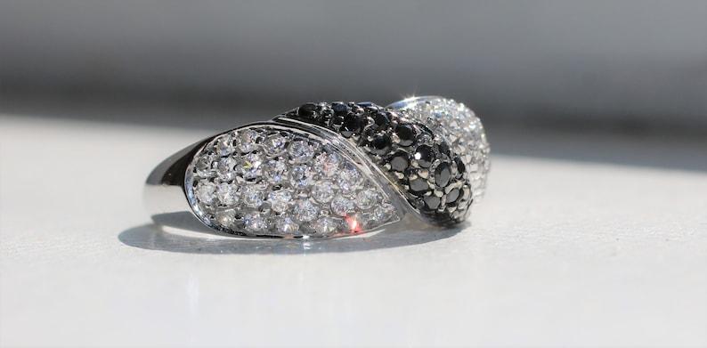14 Karat white gold infinity style ring white and black CZ stones