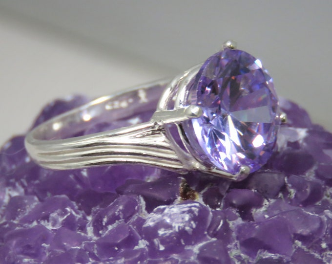 Striking Lilac Zircon Dinner Ring. 12mm Lilac Gem from Cambodia (NOT CZ). Set in Offset Swirl Sterling Silver Ring.  Incredible Fire!