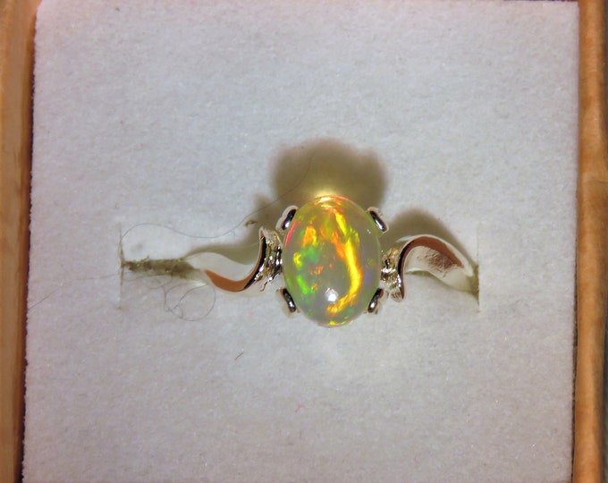 Opal. African. Ethiopian. Ring. Set in Sterling Silver. 8 x 6 mm. 1 ct. 50%+ Intro Price Reduction; Bewitching Opal w/ great color play.