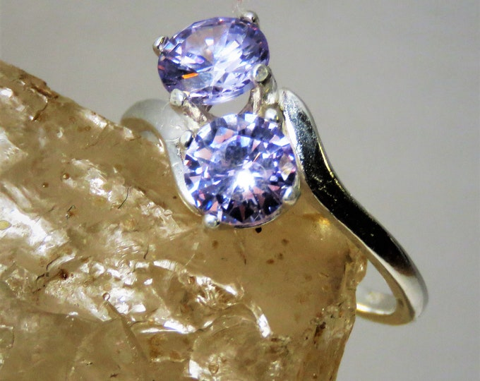 Unusual Lilac Zircon (NOT CZ) From Cambodia. Set in Double Setting Sterling Silver Ring.  Gems are 6mm, 1 Carat Each.  Beautiful, Rare Color