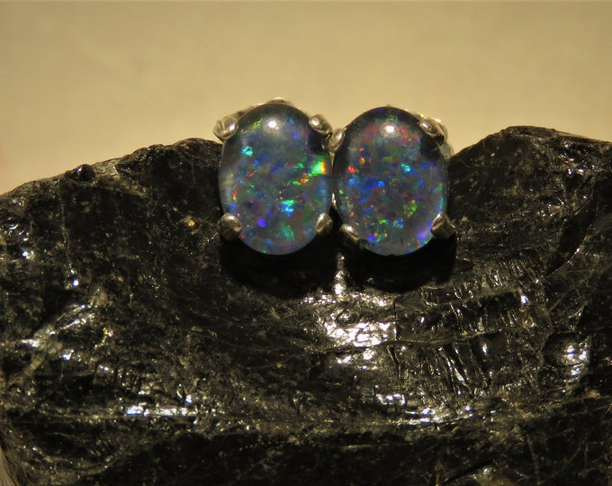 Black Opal. Earrings. Gorgeous Full Spectrum Color Play. 8x6mm Ovals Set in Sterling Silver Studs.  Rare Color!