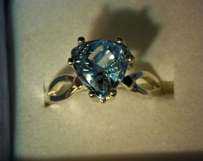 Topaz. Swiss Blue. Fr.Brazil. Fantasy Cut. 7mm Trillion Cut, Set in Sterling Silver. Introductory Price Reduced From Suggested Retail.