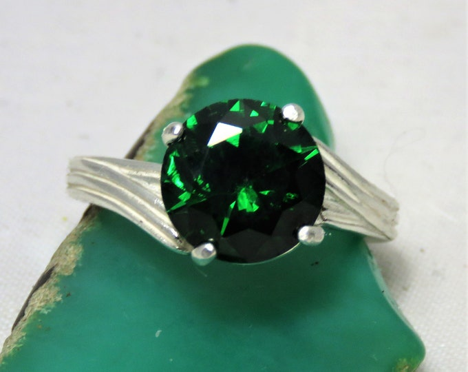 Emerald Green Zircon (Not CZ) From Cambodia. Set in a Sterling Silver Offset Swirl Ring. Very Stylish. 10mm Gem has Incredible Brilliance