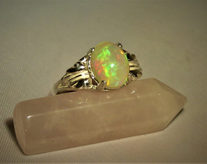 Opal. Exquisite African Opal Ring; 10mm x 8mm, excellent color play; 1.7 carats; Stunningly Beautiful ! Introductory REDUCED PRICE; 50+% off