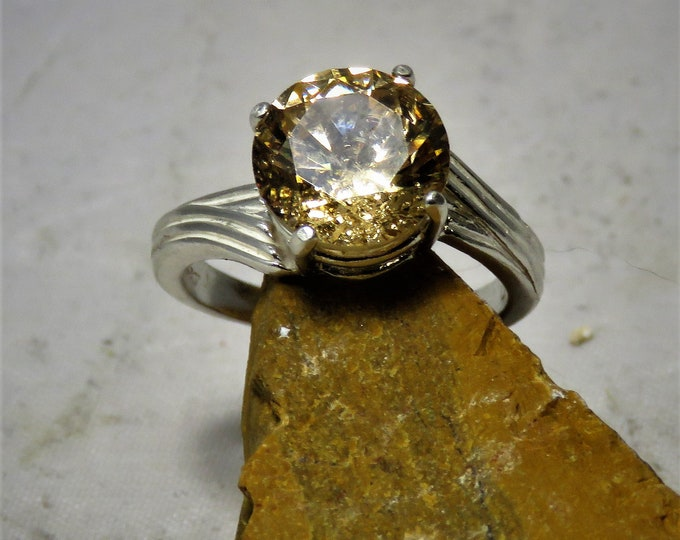 Golden Zircon Gem in Sterling Silver Offset Swirl Ring.Gorgeous Fall Color Hues, Great Brilliance and Scintillation. 10mm Gem From Cambodia.