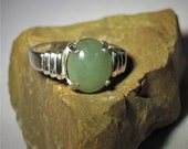 Jade. Jadeite. Creamy Green Jade From China. Near Perfect Color. Large Jade Gem, 11 x 9mm, 3.66 ct, set in sterling silver ring, size 7.