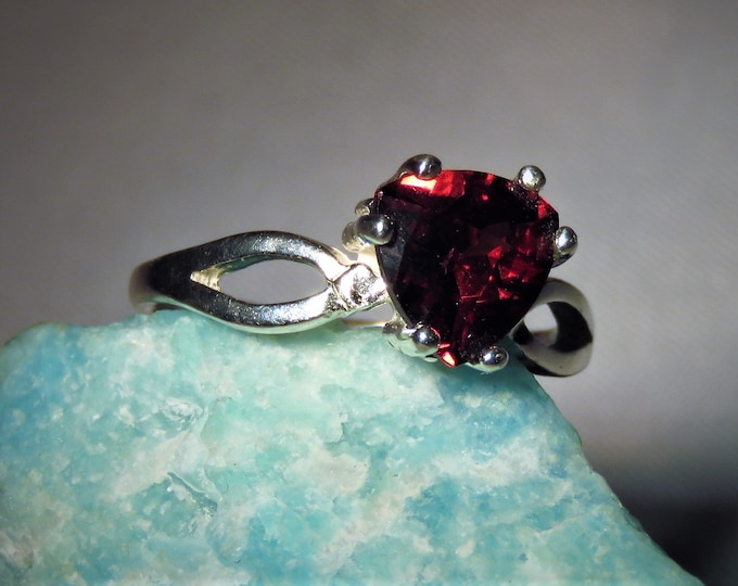 Garnet. Madagascar Red-Orange. Elegant,Beautiful Eye Clean Garnet  Set in a Sterling Silver Ring.  8mm round Gem, 2.05 carats. Size 7 ring.
