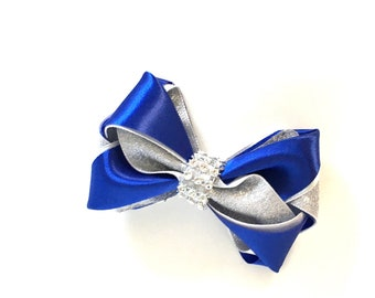 This pretty blue /silver HairBow is attached to a good quality alligator clip