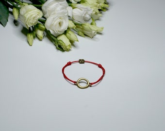 Bracelet amulet, red thread in ethno style