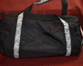 aa34193f940b Black Duffle Bag with Zebra Stripe Handles