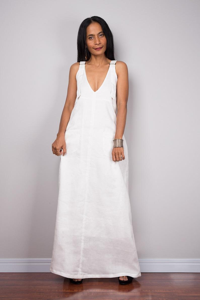 51d1e1634995 Sleeveless white linen halter top maxi dress with pockets.