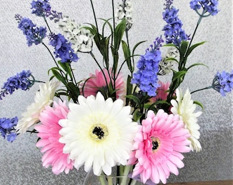 Artificial flower bouquet displaying White,Pink gerbera and lilac lavender spray. Beautiful for any room.