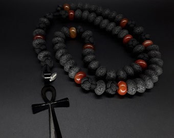The Black and Red Ankh 5 Decade Paracord Rosary made of Lava Stone, Carnelian beads and a Stainless Steel black Ankh Cross - Rosary Necklace