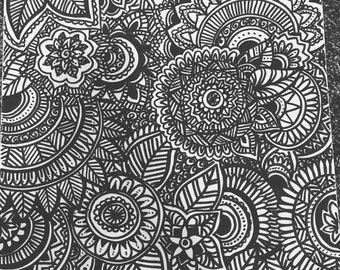 Flower mandala drawings with black marker on large canvas