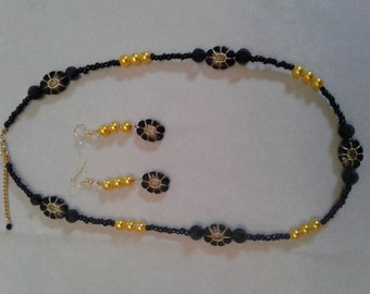 Black necklace and Pearl Gold