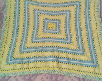 Baby afghan, crocheted in blue and yellow