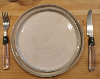 Flat plates turned cream and grey sandstone