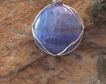 Blue Argentina gemstone cabachon wrapped in silver plate wire hung on an 18 inch chain