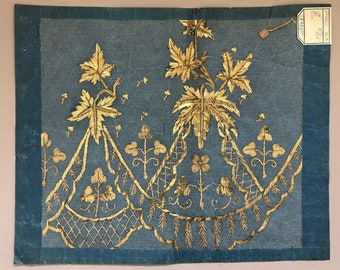 A French Textile Sample From Lyon, France. Gold Metallic Thread Hand Embroidered. Blue Paper Ground. Late 19th Century. Size: 55 x 45 cms.