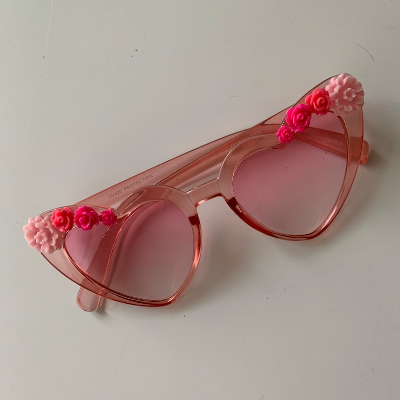 f158578dd56 Pretty in Pink  pink translucent heart-shaped sunglasses with