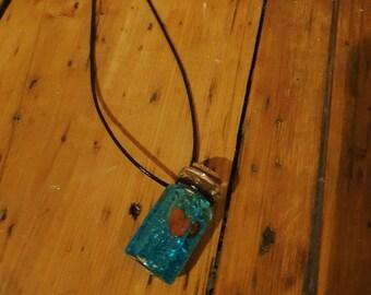 Floating heart bottle necklace