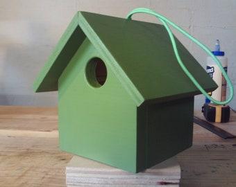 Handmade hanging wooden birdhouse