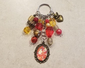 Handmade beaded red/gold angel themed keychain