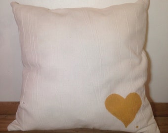White pillow with hand painted gold heart
