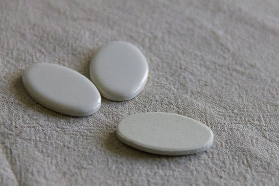 10 vintage unusual pale creamy domed rods or bars or cabochons