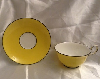Paragon plain yellow and white tea cup and saucer