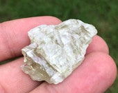 Hiddenite rough- healing ...