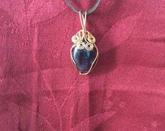 Purple Amethyst cabochon wire wrapped in copper wire