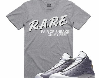 9537d11c6452 Air Jordan XIII 13 Atmosphere Grey Flight Nostalgia R.A.R.E. Retro Sneaker  T Shirt Sneakerhead Tee