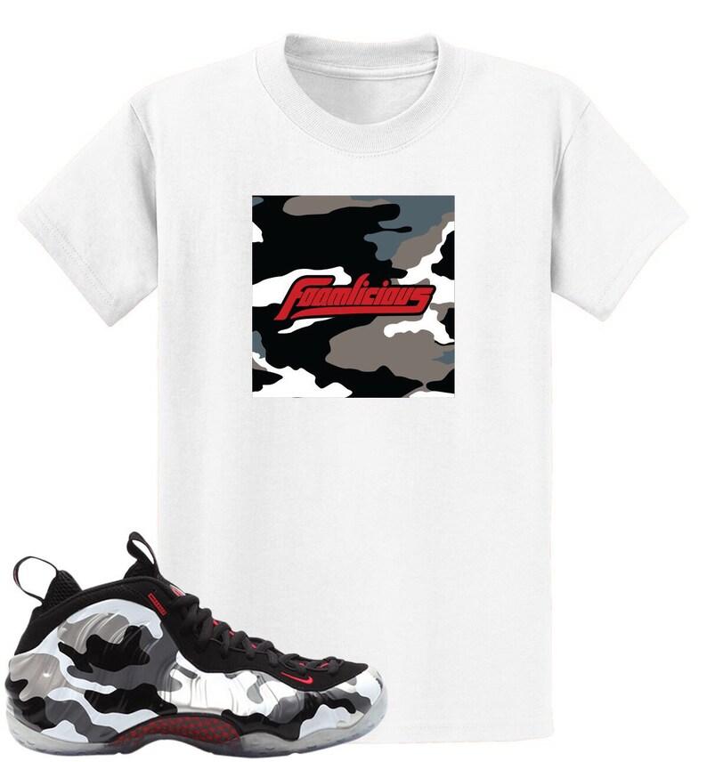 93aaf6550df21 Fighter Jet Air Foamposite One Foamlicious Box Logo T Shirt