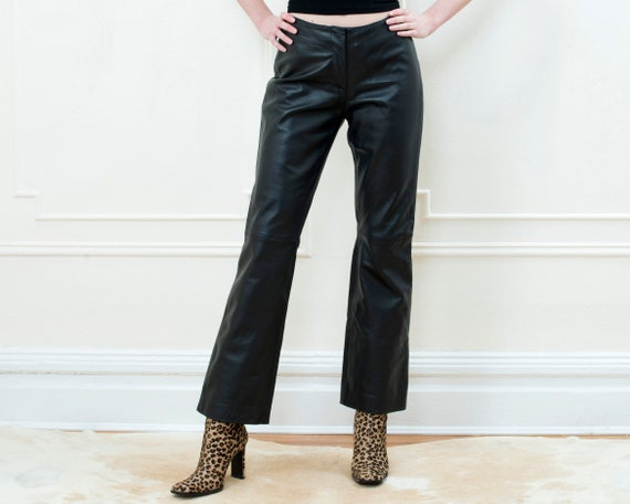 90s black leather pants small | flared leather pan