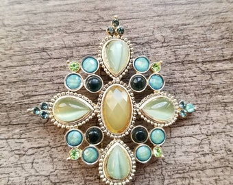 Blue and green bejeweled, diamond-shaped brooch. Old Hollywood, Gatsby-inspired style.