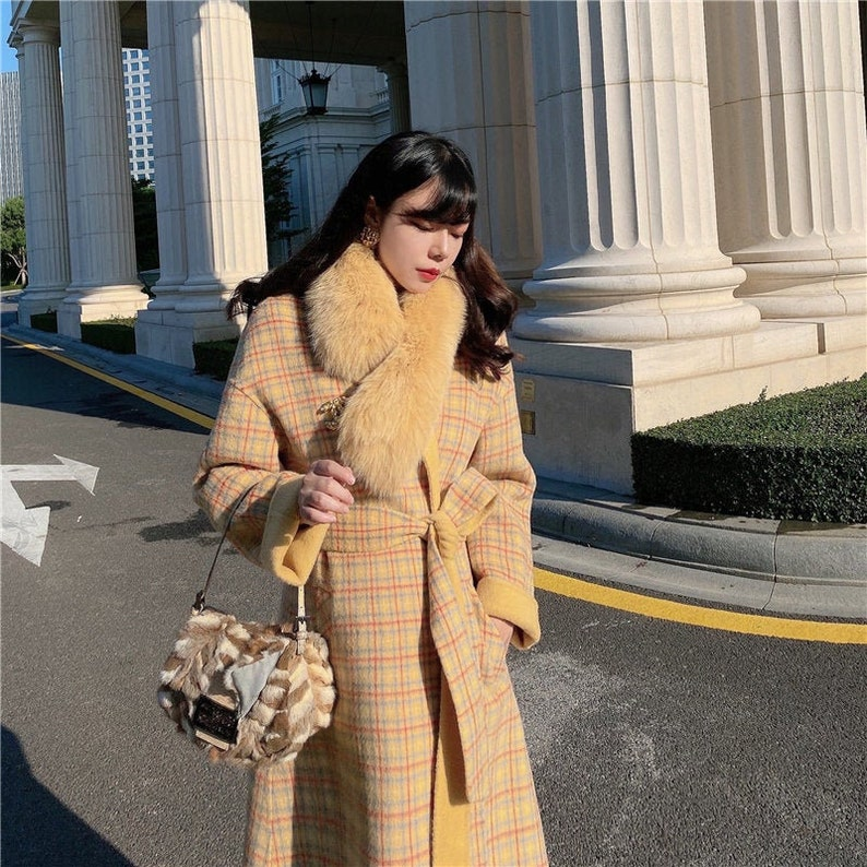 1920s Coats, Furs, Jackets and Capes History Mr. Water Winter Plaid Coat. 100% Australian Wool Coat with Pocket Belt and fox fur scarf. Light Yellow $299.00 AT vintagedancer.com