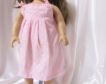 """A pink cotton jumper or dress for 18"""" dolls."""