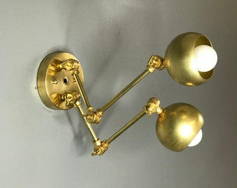 Moira Gold Raw Brass Modern Adjustable  Wall Sconce 2 Light Orb Covers Mid Century Industrial Light