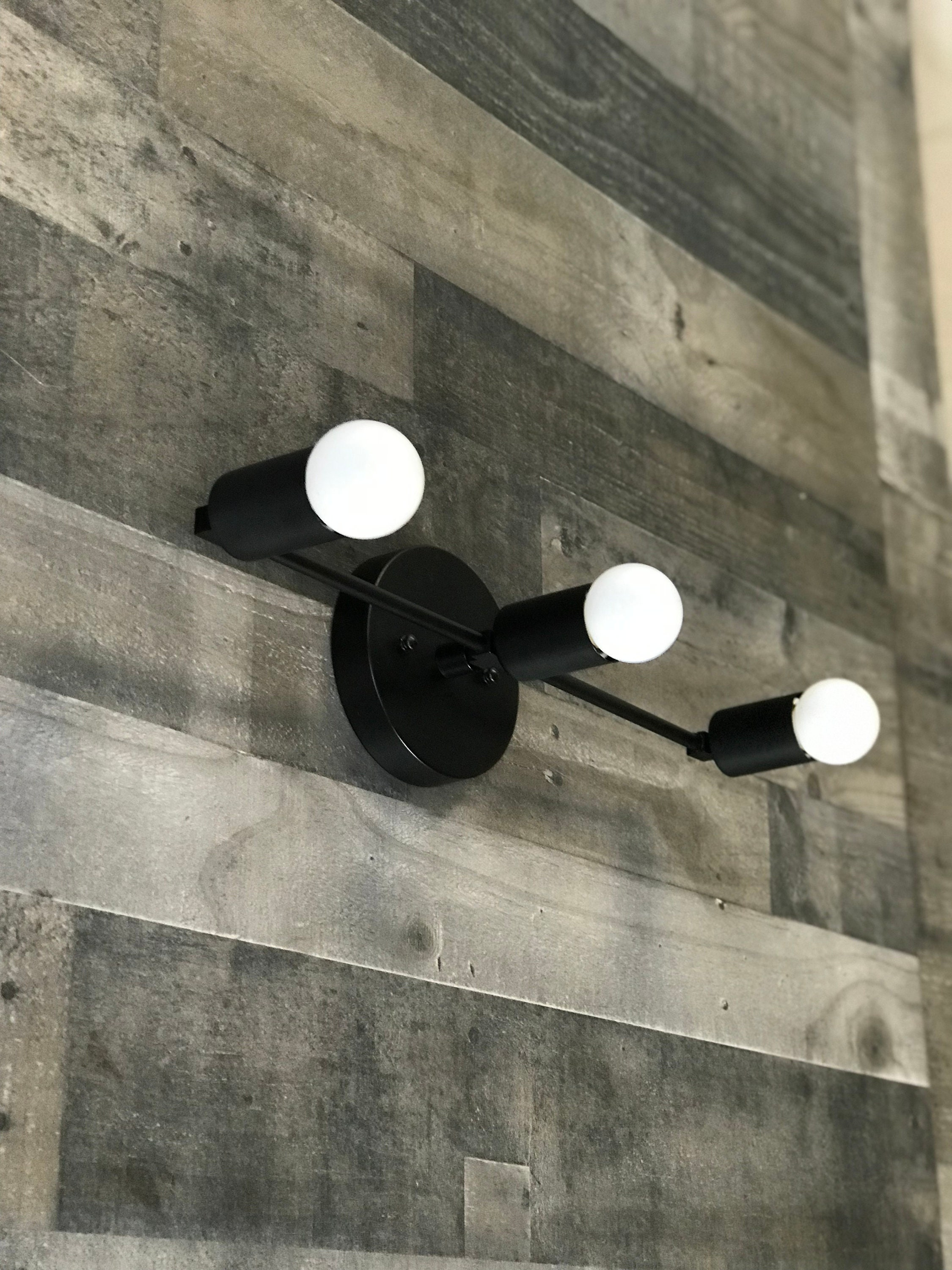 Picture of: Brontes Matte Black 3 Bulb Wall Sconce Mid Century Modern Bathroom Hallway Vanity Light