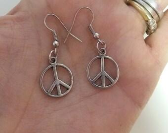 Silver earrings peace symbol. Slopes Peace