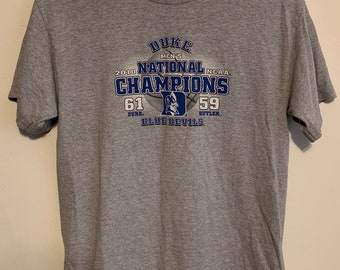 2010 Duke Blue Devils NCAA Basketball Champions Tee Youth L/Womens XS