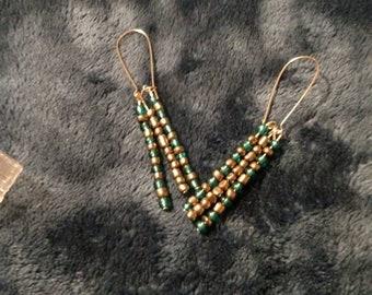 Three dangling beads. Earrings