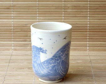 Gone with birds and dark blue waves Cup